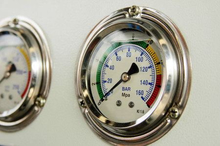 industrial machinery: industrial high pressure gauge meters Stock Photo
