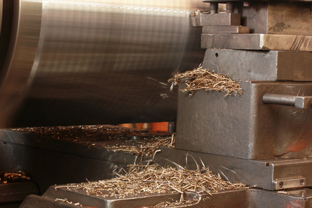 industrial machinery: Twisted Metal shavings and lathe Stock Photo