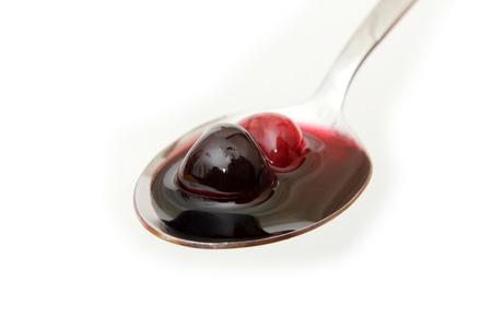 homemade tasty cherry jam isolated on white Banco de Imagens