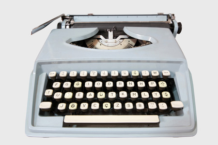 antique typewriter on white background