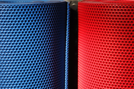 Colorful and perforated plastic grid Stock fotó
