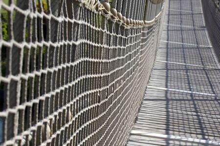 wooden suspension bridge in public park 免版税图像