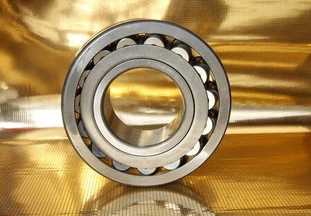 ball bearings on yellow background Foto de archivo