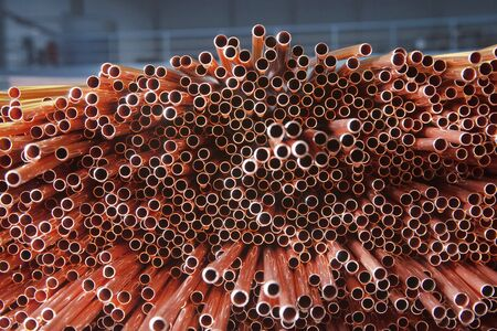 Copper pipes in factory, industrial background