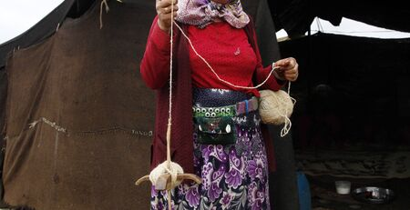 Anatolian woman spinning wool, old crafts,  goat hair