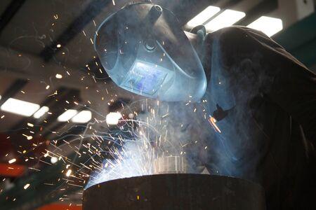 Industrial steel welder in factory.