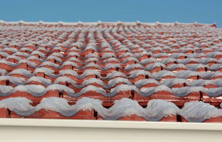 red tiles covered with snow