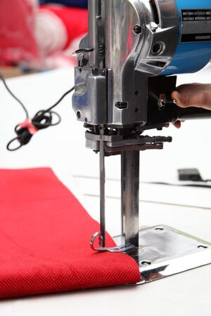 Sewing machine and fabric in textile factory 写真素材