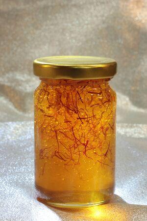 organic saffron honey in a jar