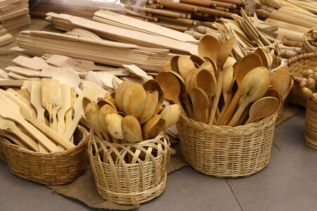 various wooden spoons in a basket