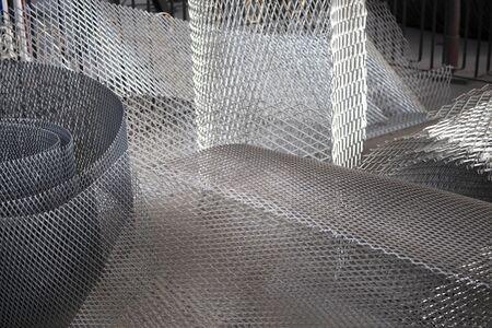 Rolls of steel wire mesh. Background.