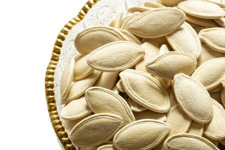 fresh pumpkin seeds in glass dish 版權商用圖片