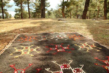 Nomad rug in nature. Nomadic life in Anatolia.