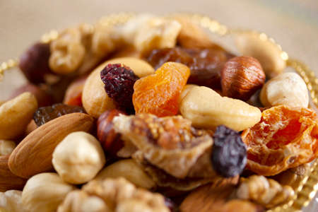 Mixed nuts in a glass plate. Healthy and natural nutrition. Cashew, Almond, Hazelnut, Fig., Walnut, Apricot, Raisin, Blueberry.