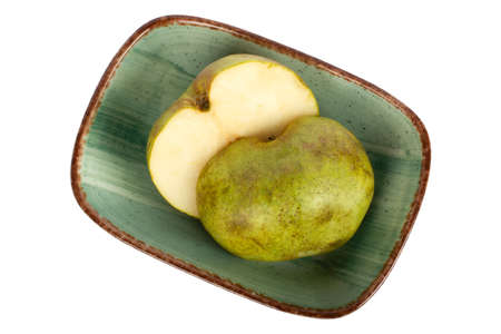 Ripe green pear in the plate