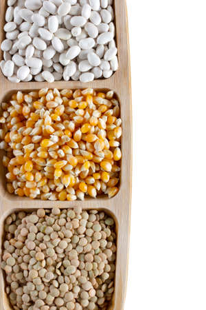 Healthy foods. White beans, dried corn and green lentils in the plate.