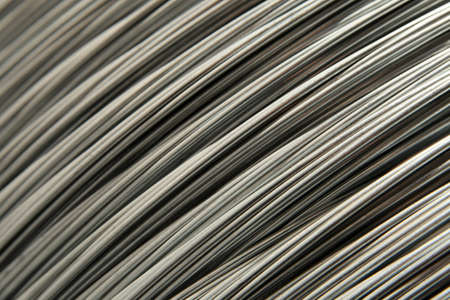 Newly manufactured steel wires. Industrial background.