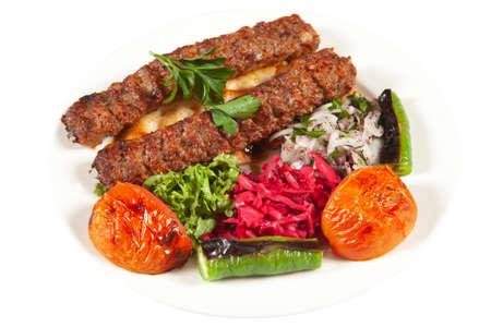 Traditional Turkish Adana Kebab and Salad Stock Photo