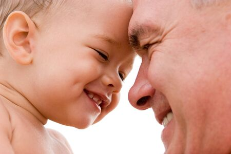 kindred: grandfather and grandchild smiling Stock Photo