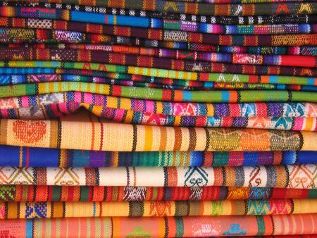 artisanry: Blankets for sale in the market in Otavalo, Ecuador Stock Photo