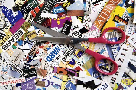 Scissors on a Magazine Background Stock Photo - 4243716