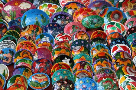 Colorful bowls for sale in market at Chichen Itza, Mexico Stock Photo