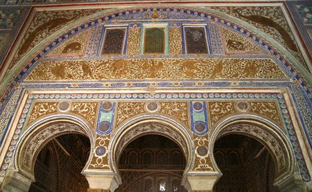 alhambra: Moorish Arches in the Alcazar in Seville, Spain