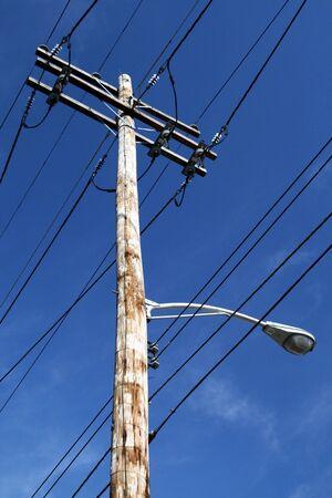 Telephone pole against blue sky in Ohio Stock Photo