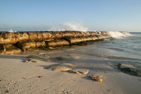 Beach and breakwater at sunset in Playa del Carmen, Mexico