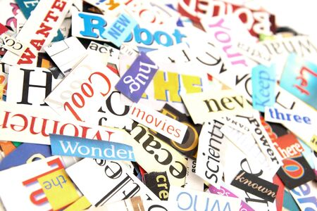Colorful words cut out from magazines form an attractive background Stock Photo