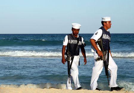Mexican Marines patrol beach in Playa del Carmen in March, 2008