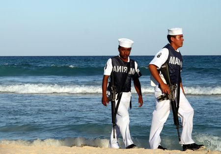 carmen: Mexican Marines patrol beach in Playa del Carmen in March, 2008