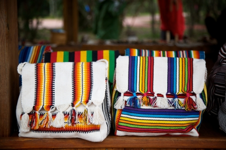 artisanry: Traditional indigenous guarani bags for sale at an outdoor market at Iguazu Falls, Argentina