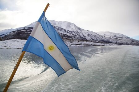 Argentinean Flag Flying in Parque Nacional los Glaciares, Argentina photo