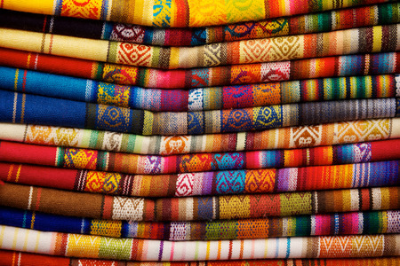 Colorful blankets for sale in market in Otavalo, Ecuador photo