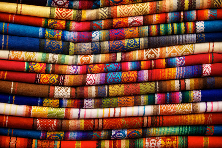 Colorful blankets for sale in the market in Otavalo, Ecuador photo
