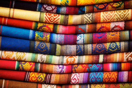 quechua: Colorful blankets for sale in the market in Otavalo, Ecuador