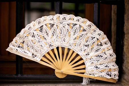 souvenir traditional: Ivory lace Spanish folding fan in Santillana del Mar in Cantabria, Spain