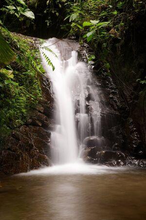 ecuadorian: Blurred waterfall in the cloudforest near Mindo, Ecuador Stock Photo