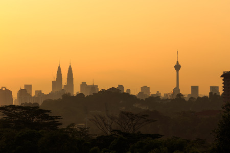 silhouette of Kuala Lumpur city with beautiful golden hour during sunrise. Stock Photo