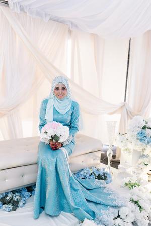 Portrait Of Malaysian Muslim Woman In Wedding Dress Sitting And ...