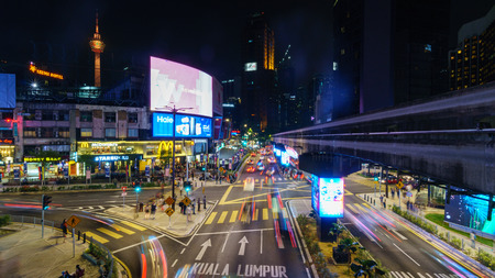 Night view of motion blur, light trails and busy traffic on Jalan Bukit Bintang in Kuala Lumpur Malaysia.