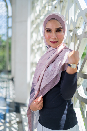 Attractive young Muslim woman with Muslimah attire.