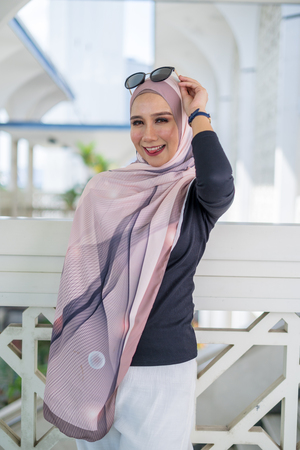 Portrait of happy young woman wearing modern stylish hijab Imagens