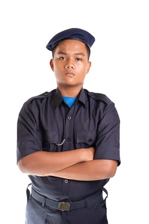 Young Asian man in policeman officer outfit isolated on white background. Copy space.