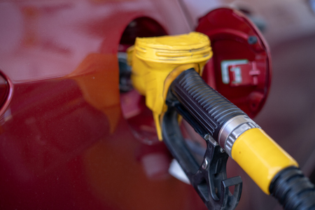 Gas or petrol nozzle for refuel vehicles, close up. Selective focus. Archivio Fotografico
