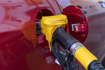 Gas or petrol nozzle for refuel vehicles, close up. Selective focus. Stock Photo