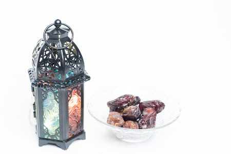Islamic decorative or ornaments, lantern and dates, kurma isolated on white background, iftar preparation, fasting in Ramadan concept. Selective focus.