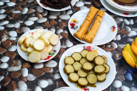 Malaysian local traditional food, lemang, ketupat, ketupat palas and other eat during eid mubarak or known as Hari Raya Aidilfitri celebration. Eat together with curry or rendang. Stock Photo