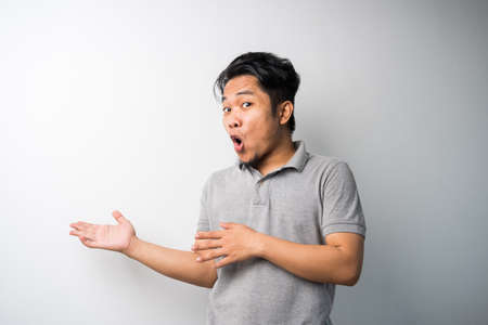 Portrait of Young Asian man, pointing with exciting, happy face expression, new fresh idea for advertisement. isolated selective focus.